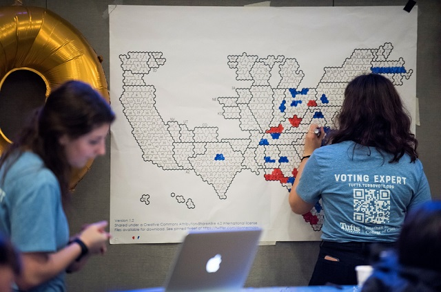 Tufts students color in election results during election night 2018