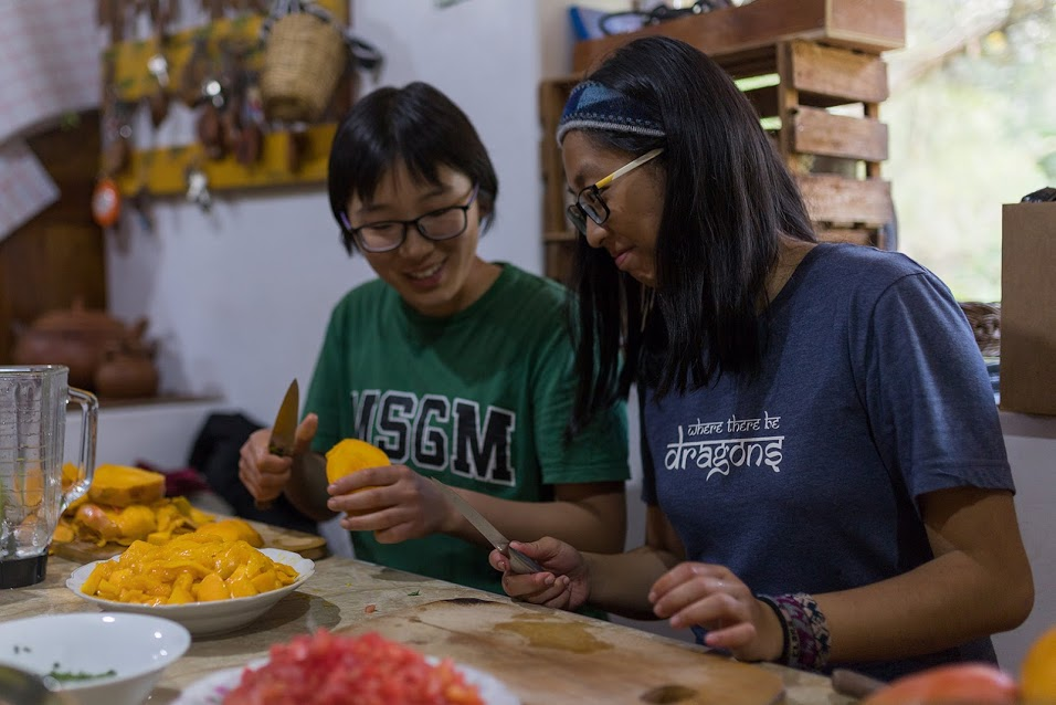 student cooking with host family