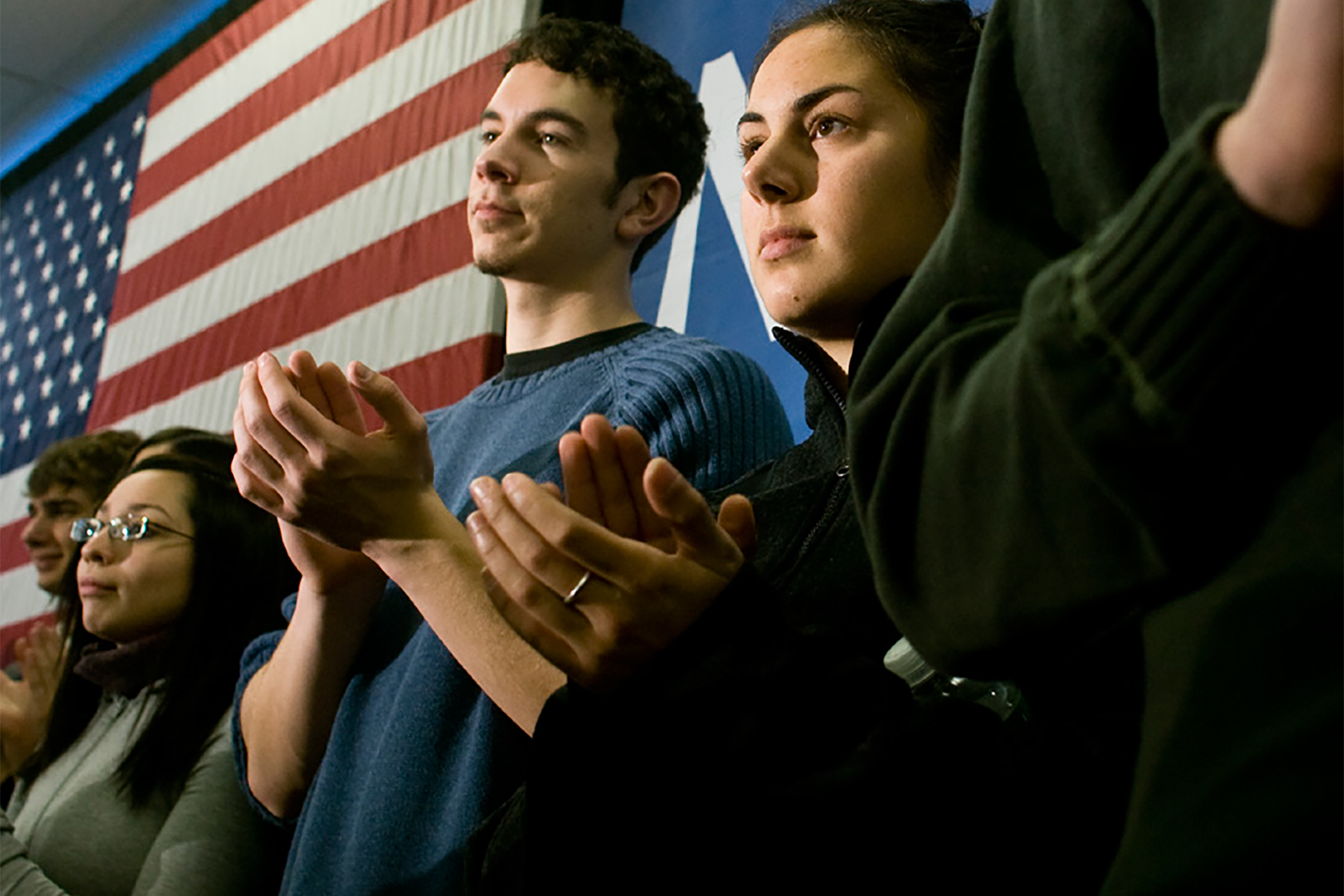 Young people clapping at an event