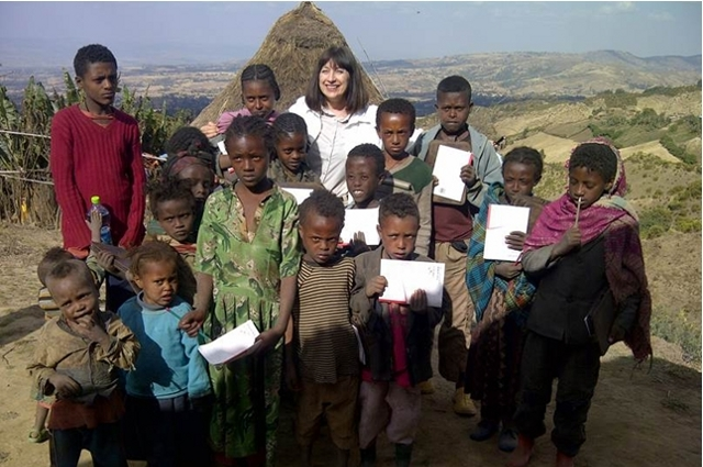 Maryanne Wolf with Ethiopian children