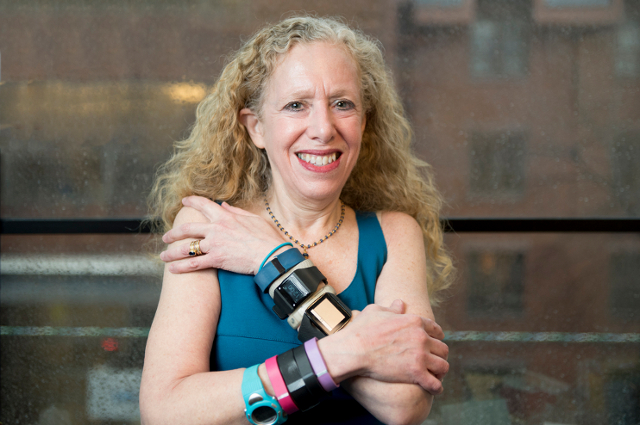 Lisa Gualtieri with many used fitness trackers