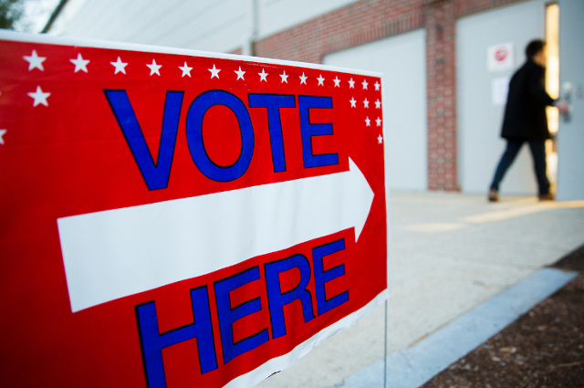 Voting sign outside polling place at Tufts