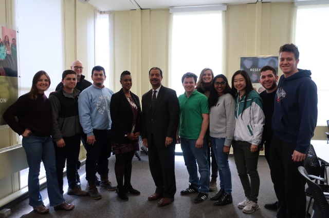 Eric Washington at Tufts, with a group of students