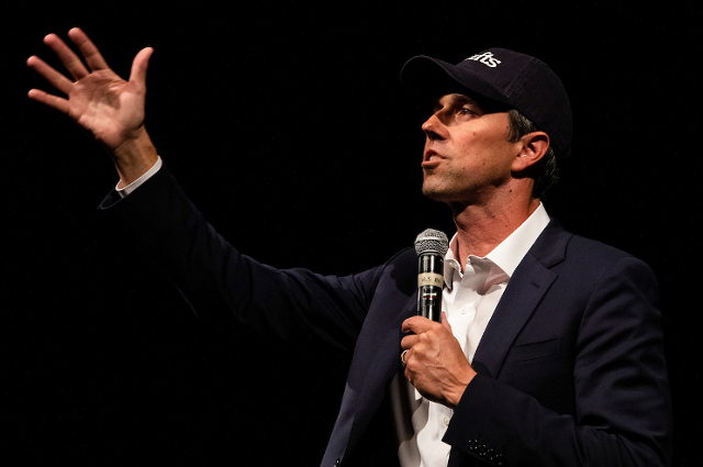 Beto O'Rourke talks with his arm outraised. The Democratic presidential candidate in talk at Tufts promised to serve those who are often overlooked