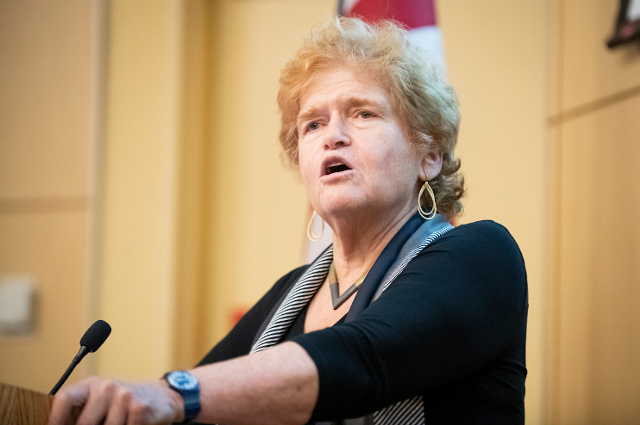 A woman speaking at a podium. Writer and Holocaust historian Deborah Lipstadt explains the nuances and dangers of modern antisemitism in a talk at Tufts