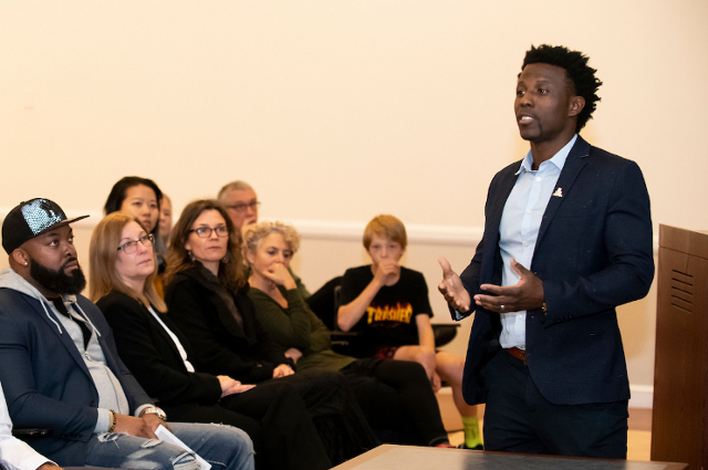 A man standing speaking to an audience. Stanley Andrisse shares his story of earning a Ph.D., becoming a professor, and advocating for reforms that support successful re-entry for formerly incarcerated people.
