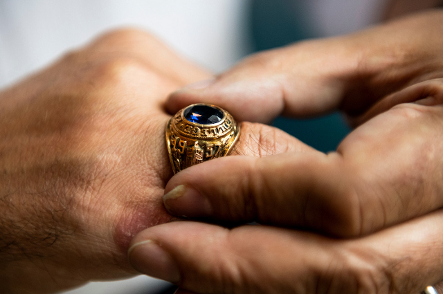 A man's class ring on a hand. Tufts writers look back over the year and talk about the stories that meant the most to them.