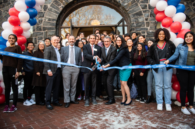 A large crown in front of a building, with a ribbon being cut with a pair of giant scissors. Tisch College Dean Alan Solomont shares his insights on how Barnum Hall reinforces the college's central role in the life of the university