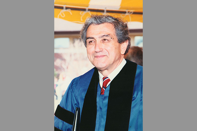 John DiBiaggio wearing academic robes. The eleventh president of Tufts, serving from 1992 to 2001, he emphasized civic engagement and strengthened the university's financial foundation
