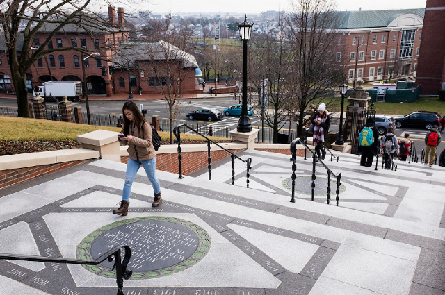 Students walk up Memorial Steps on Tufts' campus. As some students face difficulties due to COVID-19 emergency, fellow students, alumni, parents, and friends pitch in to help