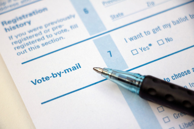 A form to apply to vote by mail, with a pen lying on it. Young voters of color are less likely to vote by mail, and getting information to millions of new voters, especially youth from low-income communities, about the process is crucial