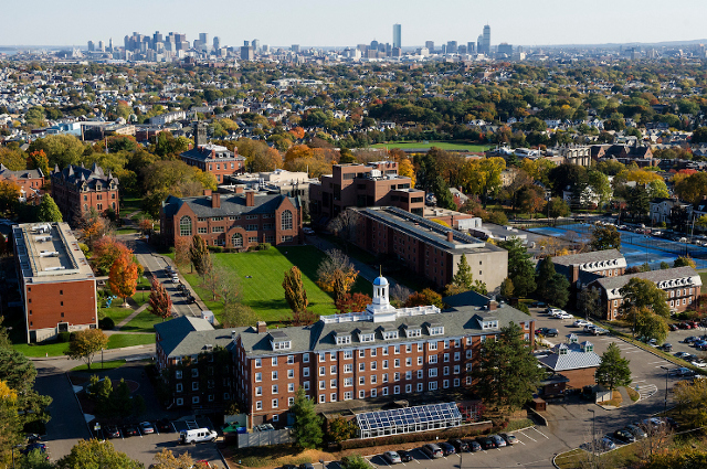 An aerial photo of Tufts' Medford/Somerville campus, with the Boston skyline in the background. Tufts files amicus brief in support of lawsuit opposing new rule that forces international students to leave the U.S. if they take all their classes online