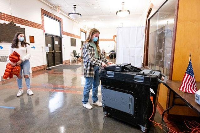 Undergraduates voted at the Cousins Gym polling place on Election Day. Photo: Alonso Nichols/Tufts University