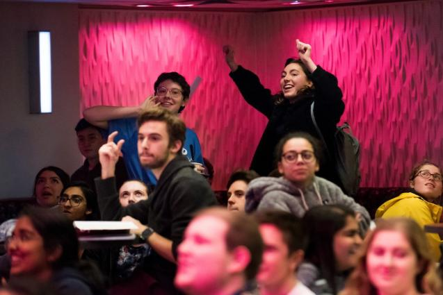 Tufts students cheer during JumboVote 2018 election night watch party
