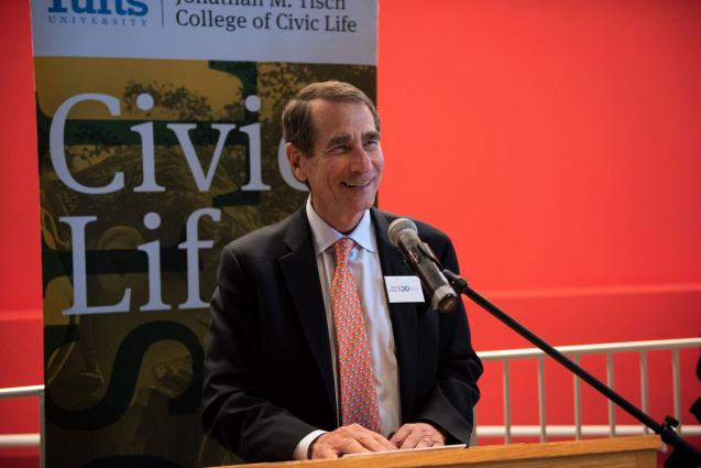 Dean Alan Solomont speaking at a podium