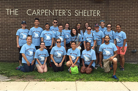 Group photo of Tufts alumni who volunteered at Carpenter's Shelter