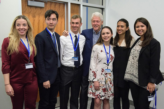 Shawn Kim, D18, with Tufts Students and President Bill Clinton at CGI U in Northeastern